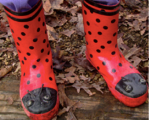 Red rubber boots with black dots and eyes on tip of the toes.