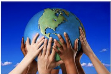 children's hands holding up a globe of the earth